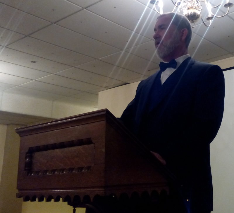 Bro. Dunning at the lectern